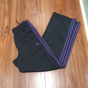 Charcoal adidas track pants with purple stripes
